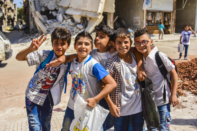A group of students find joy in the final minutes of summer school in Katarji neighbourhood, part of NRC's Child Education Program in Transition August 2018.. Katarji was one of many neighbourhoods in Eastern Aleppo affected by the conflict in 2016,  Photo: Tareq Mnadili/NRC