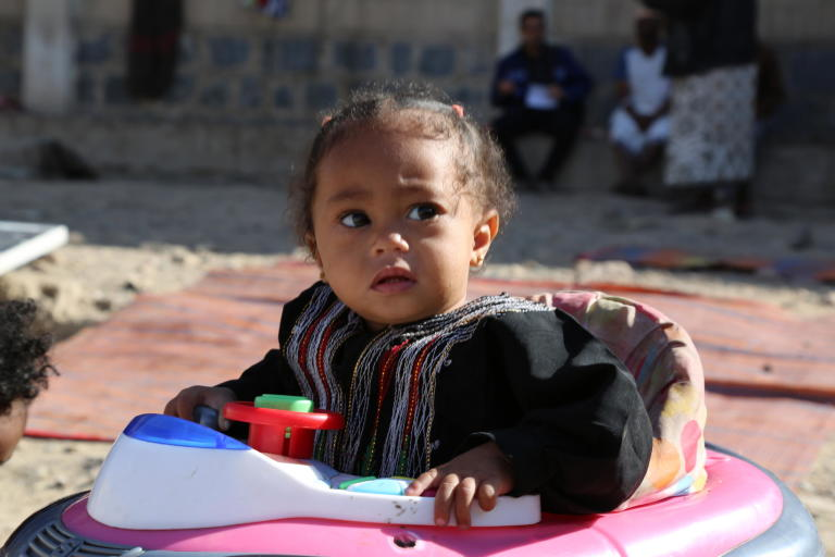 Lailah Rabei Al-Raboui, one-year-old, playing in the yard of Al-Fajr Al-Jadeed School where her family has been living since 2015 after the war forced them to flee their houses in Taiz city.  Photo: Nasser Abdulkareem/NRC