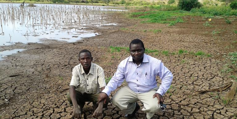NORCAP Climate Information Services Expert, Philip Omondi (right) with a local representative showing impacts of prolonged drought in Tana River County. The drought was exacerbated by 2016/2017 La Niña phenomenon (Photo: Philip Omondi/ICPAC/NORCAP)