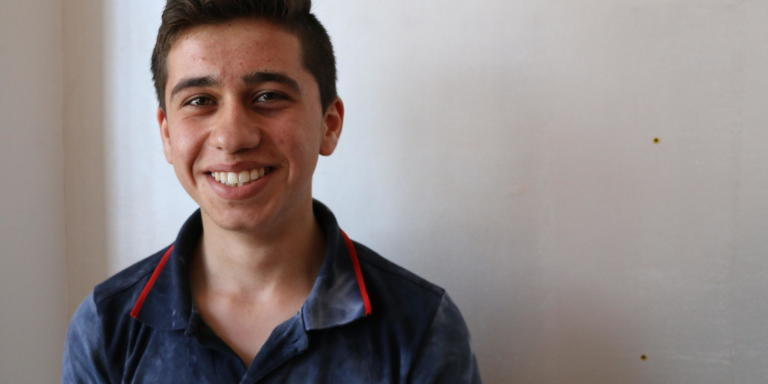 "This is Karim (17). ""I remember when I used to sleep happy and wake up happy everyday. If I was be bored I would visit my uncles, grandparents, cousins or friends. Here in Lebanon, I can barely go out since I am not able to renew my visa residency,"" says Karim.     Photo: Racha El Daoi/NRC"