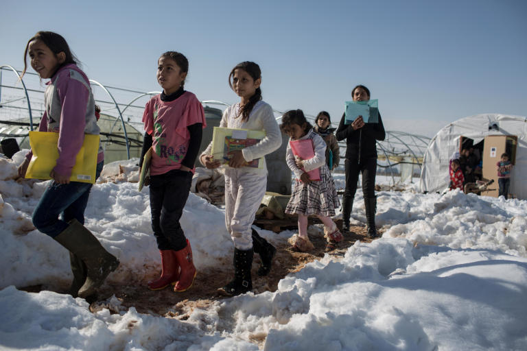Children walk home from classes run by NRC at an informal tent settlement for Syrian refugees in the Bekaa Valley, Lebanon. (Photo: Sam Tarling/NRC) 2014
