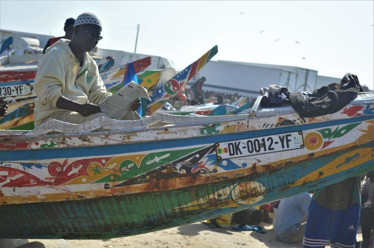 Fisherman in one of the colourful boats in Senegal. (Photo: NORCAP/Mina Weydahl 2018)
