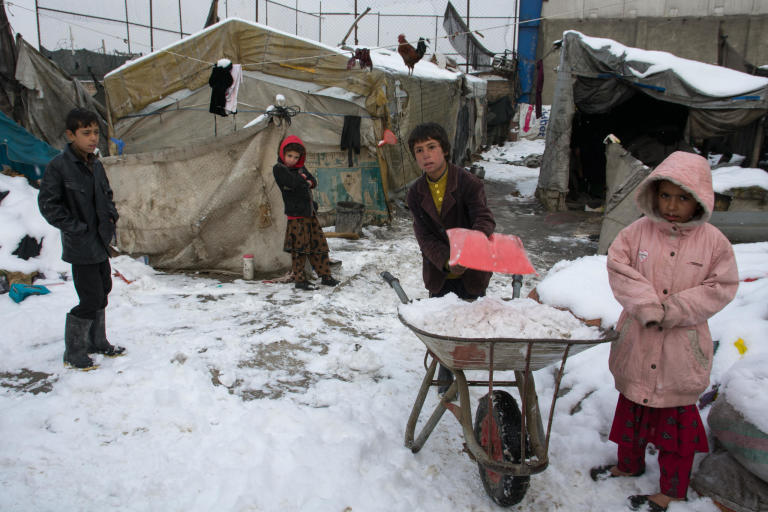 "The displaced children sweeping snow off around their makeshift tents in Kabul to stop them from sliding when it's frozen.  The first snowfall of the year is a happy news for millions of Afghans that have been badly hit by drought, but it adds misery to the life of thousands more living inside a plastic sheeting in the informal settlements in and around Kabul.   ""I was collecting scraps on the street and now the streets are blanketed with snowfall and we can't find things. i have stayed back at home and I will go back on the streets when the snow is melted,"" Said Agha Omar, 12.   None of the children on the picture go to school. They are busy collecting plastics, papers and cans on the street.  PHoto: NRC/Enayatullah Azad"