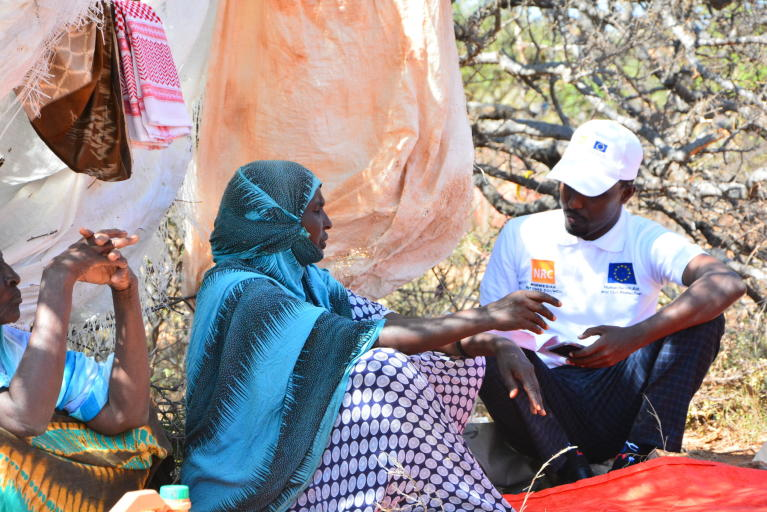 Faadumo, an old lady that has moved from Dhumey village after clan war erupted is being interviewed by NRC staff.  Fadumo now lives in Timoolay camp