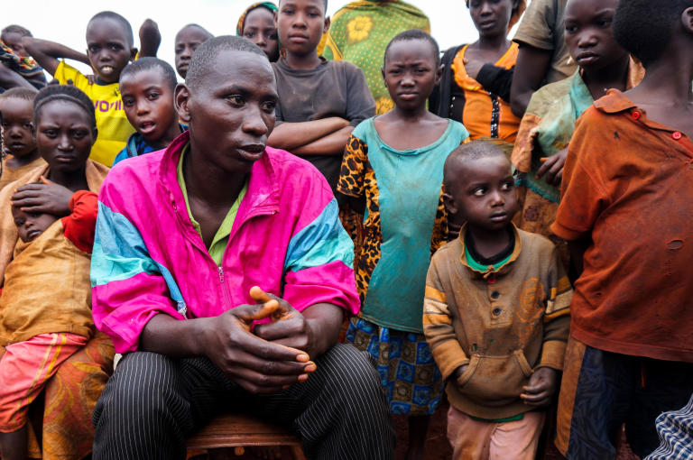 "Samson, 28, Refugee from Burundi ""I've been here with my wife and child since June 2015."" ""There was a civil war and my father was killed. The people who killed him were monitoring his children, and so we decided to leave.   I don't want to return. I have nowhere to live in Burundi. They killed my father, so I have no peace to go back, even if things settle down.  There is no future here in the camp, other than depending on WFP for food. This is my home, in this plot, I depend on it. Maybe the next time I move, it will be to resettle in a third country. Only that. I have left everything to God.""  ""We don't celebrate Christmas because there's nothing to celebrate. We have no money.""  Photo: Guri Romtveit/NRC"
