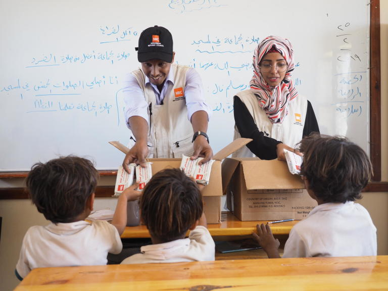 "Malka Mohammed:  NRC's education assistant in Aden, Malka Mohammed (26), remembers March, 2015 as a time that turned from being a joyful month of celebrations and weddings into a living nightmare. She was working as an English teacher in her home city of Aden when a colleague ran to her classroom, knocked madly on the door and shouted: ""They're attacking the city!""   ""We evacuated the school. There was a lot of confusion. There was shooting everywhere,"" she recounts. Over the next few weeks, it got worse and the fighting drew closer to Malka's home.   ""Every day, I heard stories of how people had been killed, and I saw the remains of destroyed buildings. It scared me to death. I was particularly afraid during those early morning hours when the airstrikes would begin.""  She remembers one day waking up to the screams of the little girl next door. ""I ran out to the street without wearing my abaya or even a scarf on my head. I was running like mad and the street was full of people. It felt like the end of the world, the sky was covered in red lightening.""  Malka and her mother ran as fast as they could. They eventually reached a house at which they felt safe and were welcomed in by the people living there. They stayed until the next morning.   A stranger helped Malka that day. Now, she is helping others.   As an education assistant in southern Yemen, her job is to make sure children living in conflict can still access school. Through our education work, we rehabilitate and rebuild schools destroyed by shelling and other attacks, we distribute school materials, teach teachers and organise school meals.  ""We cannot lose education in Yemen. If we lose education, we can lose a whole generation,"" she says, and continues: ""Education is so important, and that's why we try to support young Yemenis to create a better life for themselves, and a future.""   Yasin Ismail:  Yasin Ismail has been working for NRC for five years and believes NRC is one of the best organisation to work for. Yasin started working for NRC as an education assistant and is now an education coordinator at NRC's Aden area office.   Yasin believes education is a critical component of the workNRC does, because of its great impact on people's lives. He recognises it as a basic human right, important to the development of children and youth to fulfil their potential, and critical to breaking the intergenerational cycle of poverty.   The impact of the conflict in Yemen has been catastrophic. Schools have been destroyed or occupied by armed groups or displaced populations, which have deprived children in some areas from accessing school for more than four years.   Children in Yemen are struggling to cope with the violence they have faced during the conflict, and continue to face imminent danger as conflict carries on and exposes them to UXOs, mines and crossfire.  Yasin believes the security situation, which results in restricted access and unpredictable funding for education, are two of the main challenges in his job. He said that affected communities need access to aid but will sometimes have challenges accessing this due to long delays at checkpoints or challenges reaching distribution sites.  Yasin wants to help and support those affected by war in Yemen and believes that we can change the world with education.  ""[We should] Always follow our dreams and believe in ourselves. For every ending - there is a new beginning, for every memory - there is a dream ahead.""   ""I hope for peace and stability for our people and country. I hope for our children and youth to get quality education because that will help them to build their future. I believe the education is the only approach to protect future generations, because it gives people a chance for healthy development, restores a sense of normality, and provides important life skills. Further to that, an education intervention is an investment in the long-term future, and in the peace, stability and economic growth of Yemen"".    More information: These kids, like many others, leave for school very early because it takes them an hour - or as long as two hours for some - to walk! Ensuring children have sufficient access to nutrition is very important for children expending huge amounts of energy on commuting, learning and playing, and ensures they are able to engage appropriately in class. Lialy was among the children without anything to eat before coming to school. NRC has started to provide high energy biscuits to children in Lialy's schooll, who  expressed their happiness at receiving the biscuits. Several children mentioned feeling more energetic and active as a result, and said they could concentrate more in class.   Info about the school: Al-Qadisia school is located in Al-Qubbiyta district in Lahj and was one of the first schools in which NRC has delivered programs. NRC's team describe the AlQadisia as a normal school with an engaged community but problems including nearby landmines. As displaced families continue to move into the area, the number of students at the school continues to grow, creating congestion. NRC's program at is supporting rehabilitation of the school building, distribution of recreational, cleaning and scholastic materials, capacity building of teachers and provision of high energy biscuits for students.   Education in H2R: One of NRC's global priorities is to deliver aid and services to people in hard to reach areas. We worked with the Education department to select this school and others identified as being among the most in need. In travelling to the school form NRC's office in Aden, staff encounter several checkpoints, threatened areas and landmines.   Our programming in Yemen's southern governorates reaches people in Lahj, Abyan and Al-Dalea, among other areas. Operating in these areas is complicated and challenging: our staff travel through hostile checkpoints, some of which return traffic, preventing access to project sites. Several areas remain affected or threatened by conflict, explosions are often heard, landmines dot areas across Yemen and bureaucratic challenges delay or complicate processes.   Where mines do explode, civilians can be punished severalfold as people can not only sustain injuries, but lose mobility and access to fields and other sites used for cultivation.   Efforts should be made to call on the authorities and specialised organisations to strengthen demining operations and reduce the number of civilian casualties.     Photo: Ingrid Prestetun/NRC"