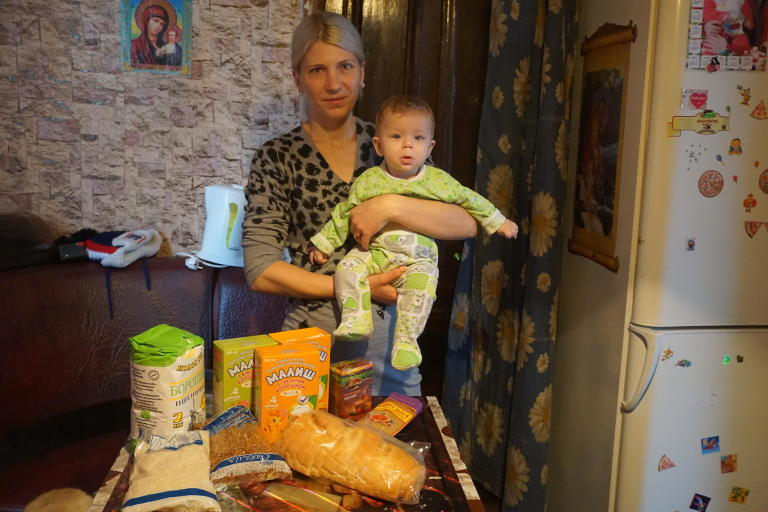 "Oleksandra Zahvodska, 32, lives in the frontline Popasna town in Luhansk oblast, she is a mother of 3 minor children. ""My husband has passed away two months ago. Now I am the only breadwinner in a family. But I cannot work as my youngest daughter is only 6 months,"" says Oleksandra. She looks into winter with fear and uncertainty, with quite small childcare allowance  she should provide for her children and heat her house. Her house does not have central heating, she uses firewood to warm it. ""For a season I need nearly 8 cub. meters of firewood, which is also costly for my family"". Recently Zahvodska received cash assistance from NRC, which will cover her family food needs for cold season, and she will spend her savings for the fuel.  Photo: Anastasiia Karpilianska/ Norwegian Refugee Council"