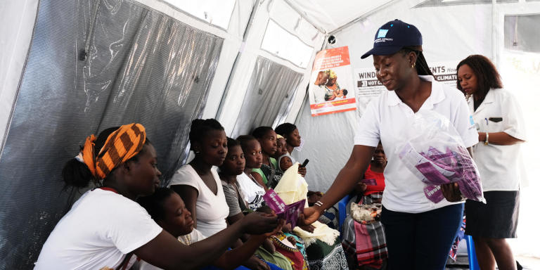 Information session on contraception and family planning at a health facility in Macharote, Mozambique. UNFPA with support from NORCAP expert, Sabine Nana, has set up tents for sexual and reproductive health programs at the health facility.  (Photo: NORCAP/Oda Lykke Mortensen)