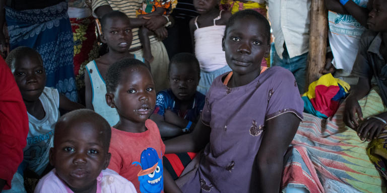 "Giramiya Weema, 25, fled DR Congo with her two children. Here she is at Kagoma Reception Centre in Uganda, waiting for a plot of land to live on. ""Life here at Kagoma is not okay,"" she says. ""The food here is never enough. My children have fallen sick, and there is not enough medical care.""  Photo: NRC/India Dwyer"