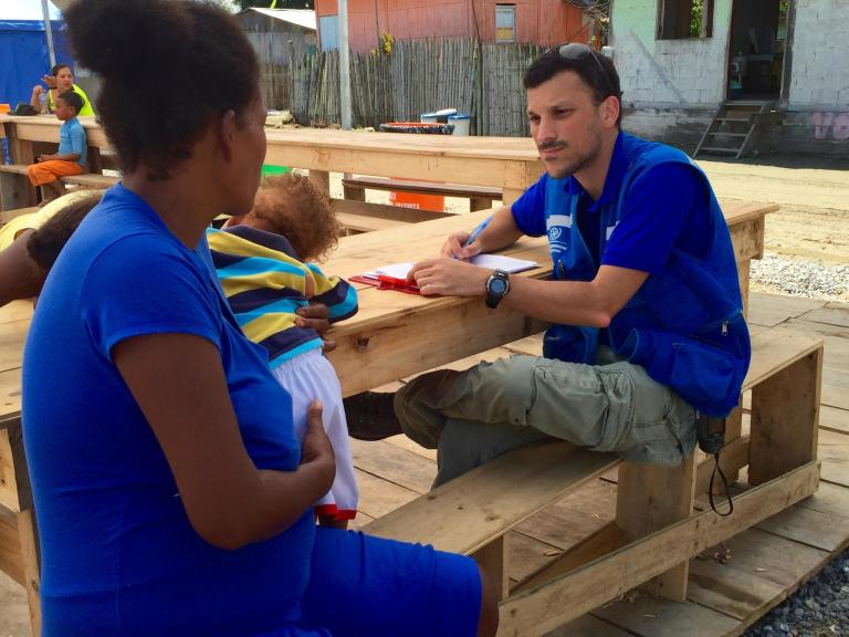 NORCAP/IOM CCCM specialist Nicolas Vexlir at Mompiche camp interviewing an IDP on camp's conditions and urgent needs. This is part of a MICS (Ministry of Interior) requested inter-agency evaluation of seven camps located on Esmeraldas Province. Esmeraldas, Ecuador, June 2016. (Photo: NORCAP/IOM/Fernanda Baumhardt)
